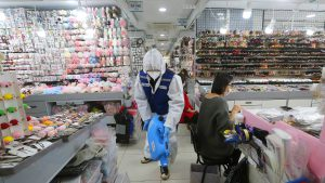 A worker wearing protective gears sprays disinfectant inside a store as a precaution against a new coronavirus at Namdaemun Market in Seoul, South Korea, Wednesday, Feb. 5, 2020. Deaths from a new virus rose to 490 in mainland China on Wednesday while new cases on a Japanese cruise ship, in Hong Kong and in other places showed the increasing spread of the outbreak and renewed attention toward containing it. (AP Photo/Ahn Young-joon)