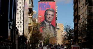 A giant electoral poster of FC Barcelona presidential hopeful Joan Laporta is seen on a building next to the Santiago Bernabeu Stadium in Madrid, Spain - December 15, 2020. REUTERS/Juan Medina